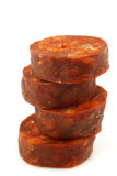 Stack of cut chorizo sausage pieces Stock Photos