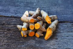 Stack of cut fresh turmeric on wood background, herb concept, traditional asian spice. Copy space cumin spicy ingredient ginger medicine health healthy food royalty free stock images