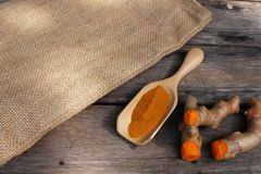 Stack of cut fresh turmeric on wood background, herb concept, traditional asian spice. Copy space cumin spicy ingredient ginger medicine health healthy food royalty free stock photos