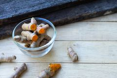 Stack of cut fresh turmeric on wood background, herb concept, traditional asian spice. Copy space cumin spicy ingredient ginger medicine health healthy food stock image