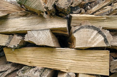 Stack of cut and stacked firewoods, background. Closeup photo wi Royalty Free Stock Photos