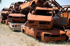Stack of damaged rusted car scraps on junkyard Royalty Free Stock Photography