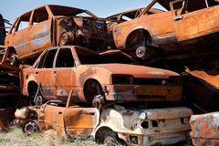 Stack of damaged rusted car scraps on junkyard Royalty Free Stock Photo