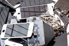 Stack of damaged smart phone body and cracked LCD screen. Stack and piles of damaged smart phone body and cracked LCD screen royalty free stock image