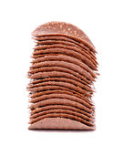 Stack of dark chocolate chips is isolated on white background, c Stock Image