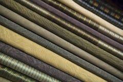 Stack of dark folded textile fabrics Stock Photo