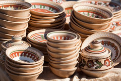 Stack of decorated handmade ceramic ware at the ha Stock Images