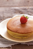 Stack of delicious pancake with strawberry topping Royalty Free Stock Images