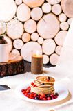 A stack of delicious pancakes with berries and honey royalty free stock image