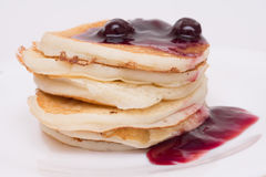 Stack of delicious pancakes with cherry jam Stock Image