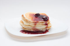 Stack of delicious pancakes with cherry jam Stock Images