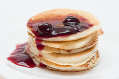 Stack of delicious pancakes with cherry jam Stock Photos