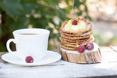 A stack of delicious pancakes with honey and blueberries on a wood background. with copy space stock photos
