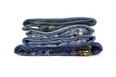 A stack of denim trousers on a white background Royalty Free Stock Photo