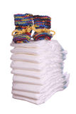 Stack of diaper with baby shoes. On white background Stock Image
