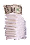 Stack of diaper with dollar note Royalty Free Stock Images