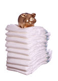 Stack of diaper with golden piggybank Royalty Free Stock Photos
