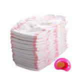 Stack of diapers with babys dummy Royalty Free Stock Images