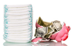 Stack  diapers, broken piggy bank and money isolated on white. Stock Photos