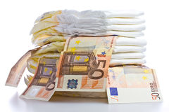 Stack of Diapers and Euro Banknotes stock photography
