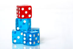 Stack of Dice. Stack of blue and red dice on a white background royalty free stock image