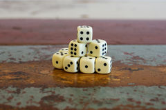 Stack of dice on table Royalty Free Stock Photography