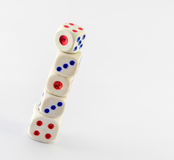 Stack of dice on white background with copy space royalty free stock images