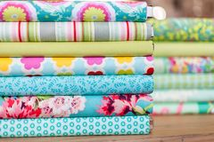 Stack of different colorful fabric rolls royalty free stock photos