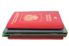 Stack of documents with passport. Stack of different documents with russian passport on top isolated on white background. Difficult bureaucracy concept royalty free stock photo