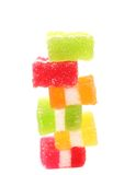 Stack of different fruit-paste candies. On a white background Royalty Free Stock Image