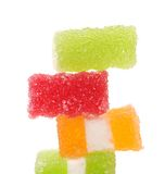 Stack of different fruit-paste candies. On a white background Royalty Free Stock Photos
