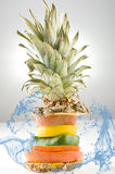 Stack of different fruit slices splashed by water, concept for health care,withered pepper (shrivel), dry pineapple top Stock Photography