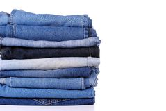 Stack of different kind of blue jeans Stock Photos