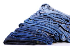 Stack of different kind of blue jeans Royalty Free Stock Photo