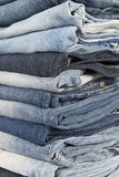 Stack of different old worn blue jeans Royalty Free Stock Images