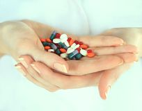 Stack of different pills in woman hands Royalty Free Stock Image
