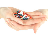 Stack of different pills in woman hands Stock Image
