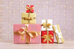 Stack of different presents on festive background stock photo