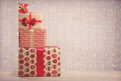 Stack of different presents on festive background royalty free stock photo