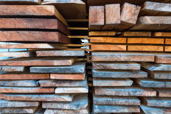 Stack of different size cut wood planks for building constructio Stock Photo
