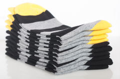 Stack of different socks on the white Stock Photo
