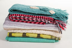Stack of different winter scarves. Stock Image