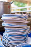 Stack dishes. Arranged, art, background, balanced, color, concept, crockery, descending, dirty, dish, dishes, dozen, equal, even, horizontal, idea, life, mess stock photography