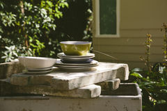 Stack of Dishes in a dilapidated garden Royalty Free Stock Photos