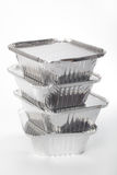Stack of disposable pans. Stack of disposable aluminum baking pans against white background Royalty Free Stock Photography
