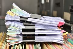 Stack Document file. And black PaperClip pace on Cabinet in office stock images