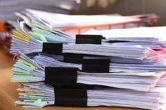 Stack Document file. And black PaperClip pace on Cabinet in office stock photography