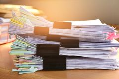 Stack Document file. And black PaperClip pace on Cabinet in office stock photo