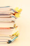 Stack of documents. Pile of documents and file folders on bright background stock photography