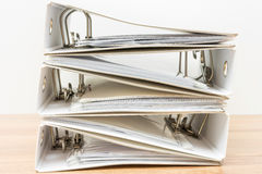 Stack of documents in binders on white background Royalty Free Stock Image